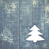 Christmas tree made of white felt on wooden, blue background. Sn Stock Images