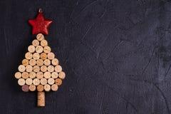 Christmas tree made of wine corks. Mockup, layout, flat lay. New Year winter season concept, background. royalty free stock photo