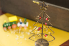 Christmas tree made of wire. A Christmas tree made of wire and a choo-choo train Royalty Free Stock Photo