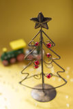 Christmas tree made of wire. A Christmas tree made of wire and a choo-choo train Royalty Free Stock Image