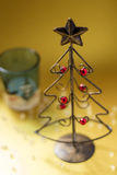 Christmas tree made of wire. A Christmas tree made of wire and a glass candle holder Royalty Free Stock Image