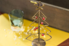 Christmas tree made of wire. A wire christmas tree and glass with snowman illustration Stock Photos