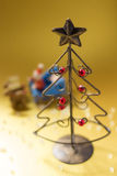 Christmas tree made of wire. A Christmas tree made of wire and Santa Clause and reindeer Stock Photo