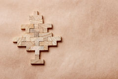 Christmas tree made of wooden bricks on brown background Royalty Free Stock Image