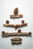 Christmas tree made of wooden twigs and cones Stock Image