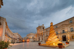 Christmas tree in the main square in Syracuse. Wide view of Syracuse's main square, under a cloudy sky, at Christmas time, with a beautiful and artistic Royalty Free Stock Photography