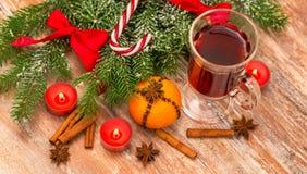Christmas tree, mandarine, glogg and candles Stock Photos