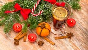 Christmas tree, mandarine, glogg and candles Royalty Free Stock Photo