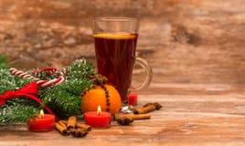 Christmas tree, mandarine, glogg and candles Stock Images