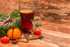 Christmas tree, mandarine, glogg and candles Royalty Free Stock Photography