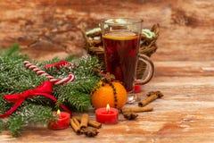 Christmas tree, mandarine, glogg and candles Stock Image