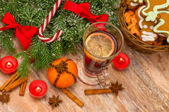 Christmas tree, mandarine, glogg and candles Royalty Free Stock Images