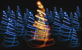 Christmas tree with many colors in the dark nigt Royalty Free Stock Photo