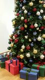Christmas tree with many differently colored christmas balls. Artificial Christmas tree withj many brightly differently colored Christmas balls decorated and Royalty Free Stock Photography