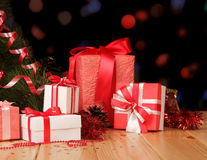 Christmas tree and many gifts on abstract dark. Royalty Free Stock Photography