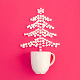 Christmas Tree of marshmallow and cup, on a pink background Royalty Free Stock Photography