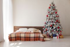 Christmas tree in the master bedroom bed holiday gifts new year White House decor stock images