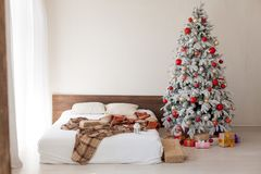Christmas tree in the master bedroom bed holiday gifts new year White House decor royalty free stock photography