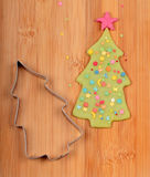 Christmas tree and metal cutter Stock Images
