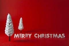 Christmas Tree. Miniature Christmas Tree on red background Royalty Free Stock Photo