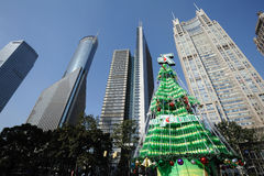 Christmas tree with modern building in shanghai. Seven Up Christmas tree,locate in Shanghai Lujiazui business and financial center stock images