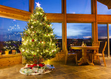 Christmas tree in modern home. Beautiful decorated Christmas tree in a modern home with large windows Stock Photography