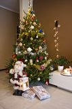 Christmas tree in modern room Royalty Free Stock Photography
