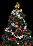Christmas tree with money dollar garland. Royalty Free Stock Image