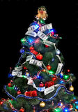 Christmas tree with money dollar garland. Stock Photo