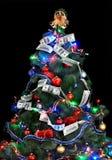 Christmas tree with money dollar garland. Black background Stock Photo
