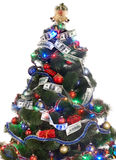 Christmas tree with money dollar garland. Isolated Royalty Free Stock Images