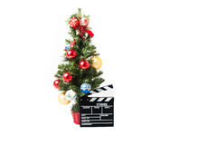 Christmas tree and movie clapperboard Royalty Free Stock Images