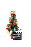Christmas tree and movie clapperboard Royalty Free Stock Photography