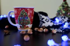 Christmas Tree Mug on a Decorated Table. Christmas Hot Chocolate with Decorations Stock Photos