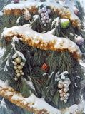 Christmas tree with multi-colored decorations. Outdoors Stock Photos