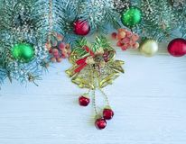 Christmas tree branch, natural snow on season winter decorative table celebration wooden background. Christmas tree natural branch ball on wooden background stock images