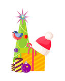 Christmas Tree near Present Box and Santa Cap. Decorated Christmas tree with balls, garlands and star on top near xmas box with Santa Claus cap on it and striped Stock Image