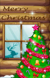 A christmas tree near the window Stock Photography