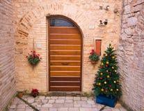 Christmas tree near wooden door in Spello Stock Image