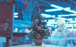 Christmas tree and neon lights, fluorescent lamps in blur, Royalty Free Stock Image