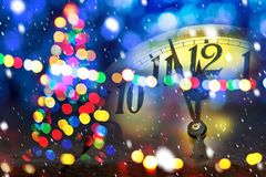 Christmas tree with new year clock. Before midnight stock image