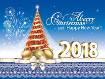 2018 Christmas tree. New year tree with fireworks and Christmas decorations on a blue background Stock Image