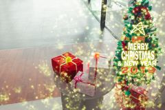 Christmas tree, new year, 2019, gift, happy, santa, count down. Box, Chistmas tree blurred background with gift box for merry christmas and happy new year 2019 royalty free stock image