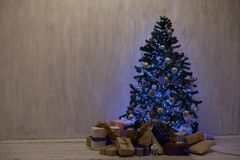 Christmas tree with presents, Garland lights new year holiday decor royalty free stock images
