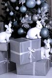 Christmas tree. New Year.gifts under the tree. bunny figures Stock Image