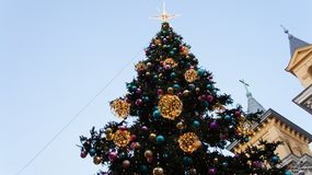 Christmas Tree in Street, Wednesday, December 13, 2017. Christmas Tree, The New Year is knocking at the door. New Year& x27;s ball on a Christmas tree in the royalty free stock image