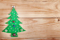 Christmas tree. New Years decoration on wood background