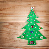 Christmas tree. New Years decoration on wood background Royalty Free Stock Images