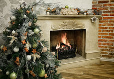 Christmas tree next to marble fireplace Royalty Free Stock Photography