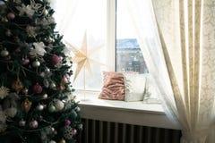 Christmas tree next to a window. Royalty Free Stock Photo